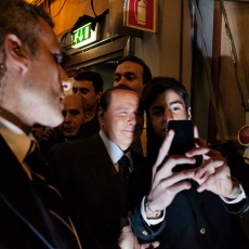 "Roma, febbraio 2013. Silvio Berlusconi fotografato da un fan mentre lascia lo studio del programma televisivo ""Ballarò"". Rome, February 2013. Silvio Berlusconi is photographed by a fan while leaving the studio of the television programme ""Ballarò""."